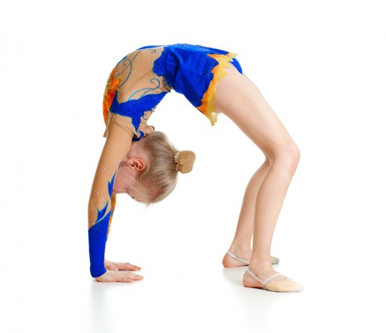 little girl in leotard doing a backbend