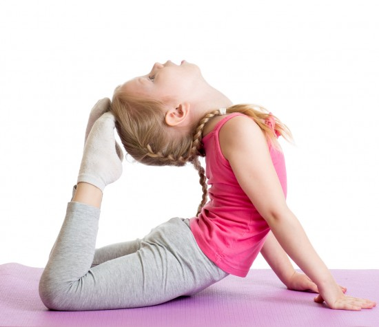 little girl touching her toes to her head as part of a gymnastics class