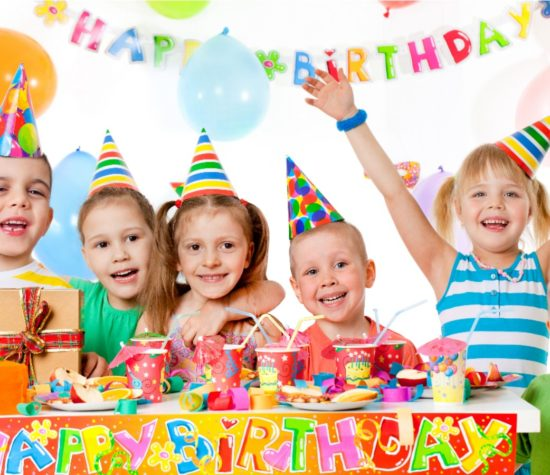 Children smile at a birthday party.