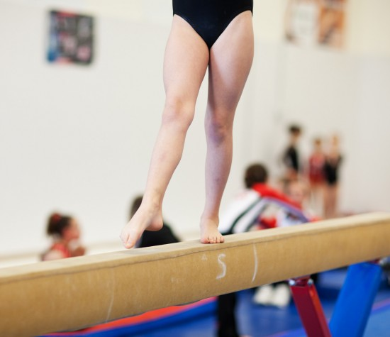girl balancing on the bar