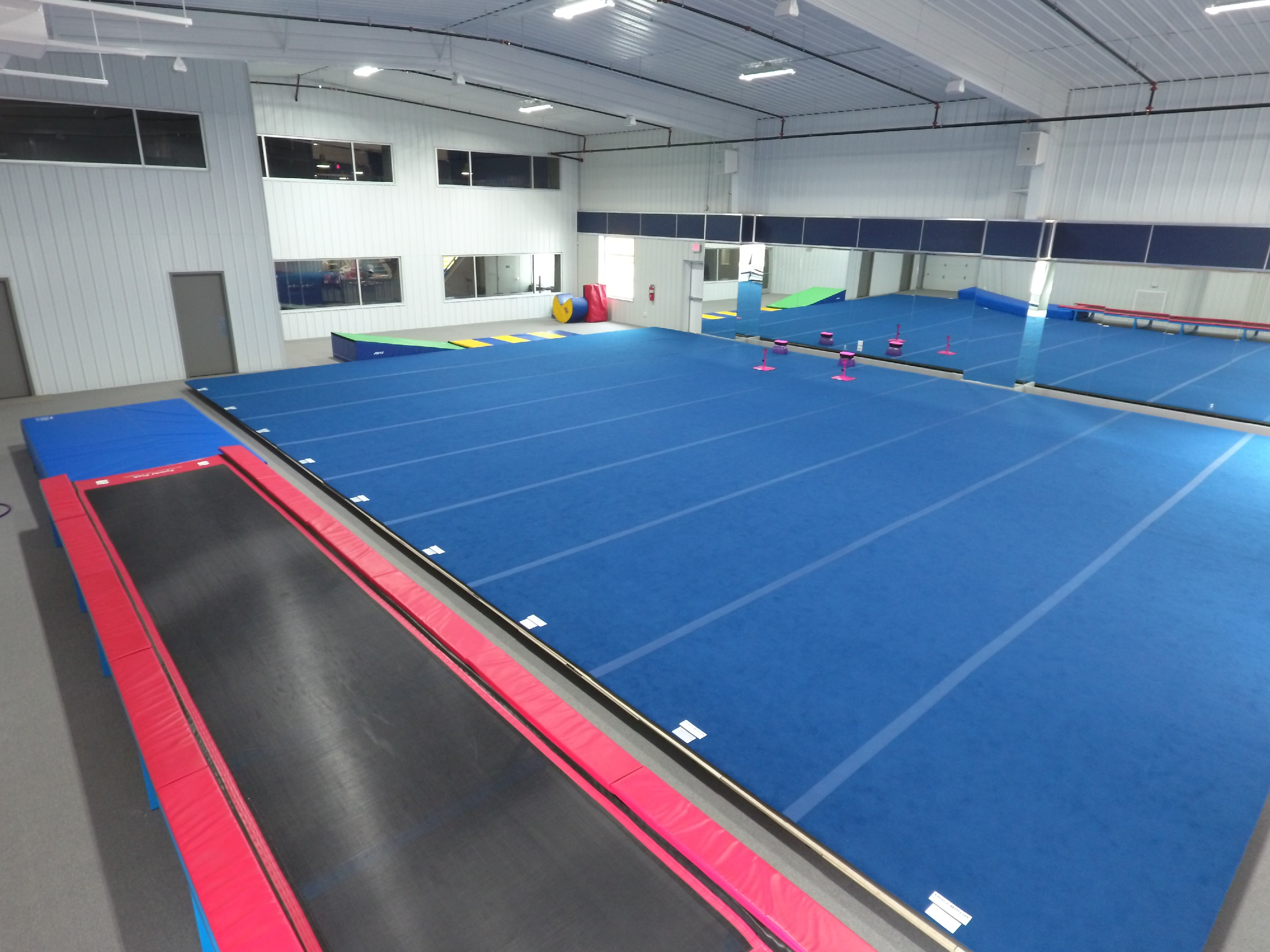 image of gymnastics gym with trampoline and large mat