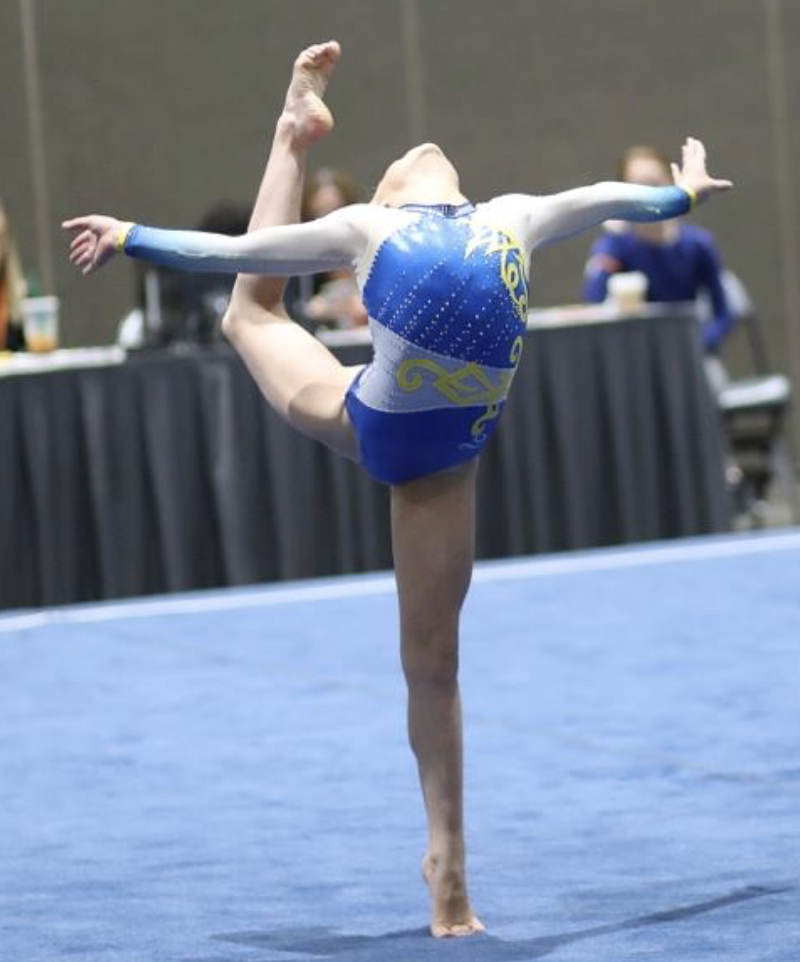 Girl improving her flexibility at a competition
