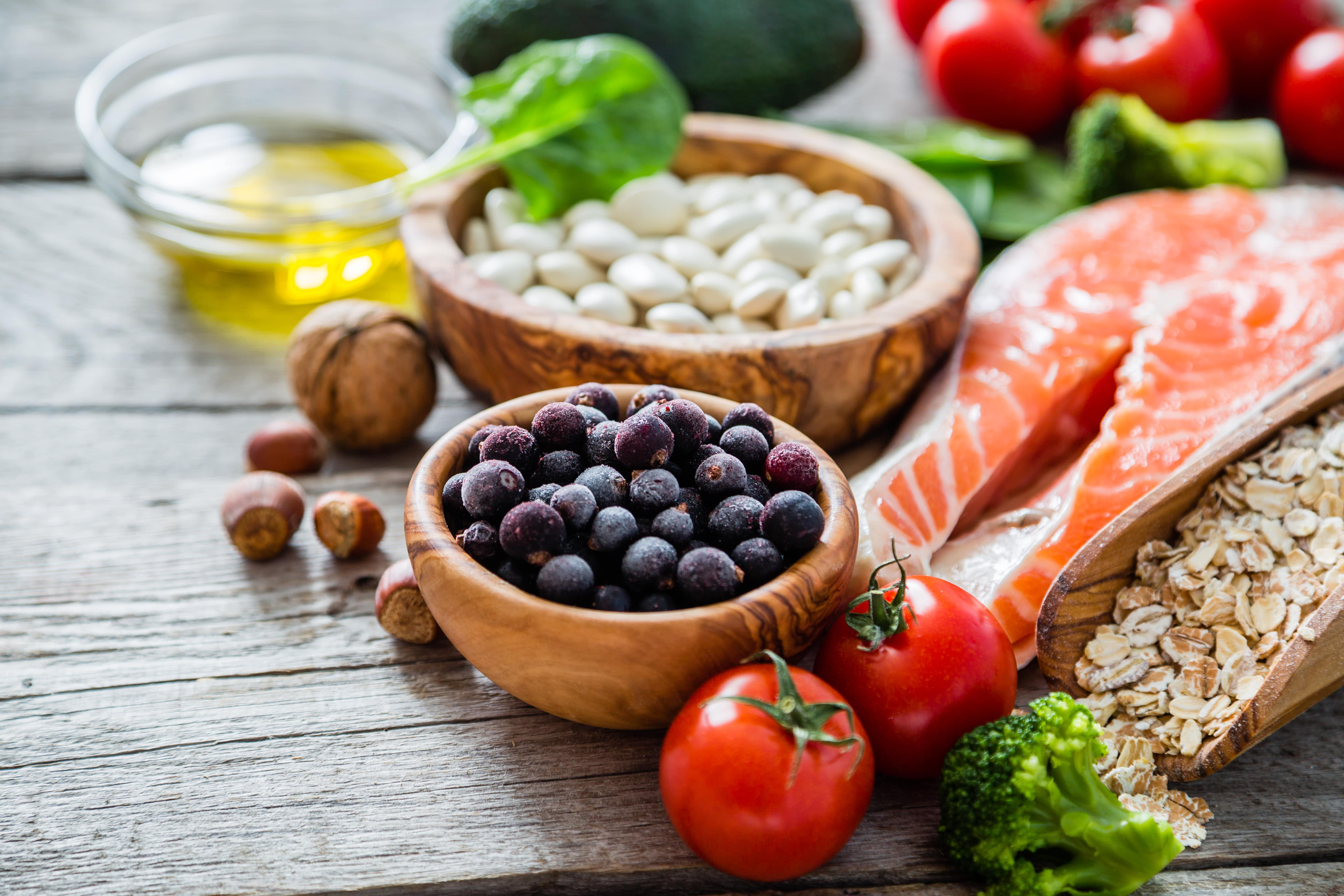 Image of various healthy foods sitting on a rustic wooden table