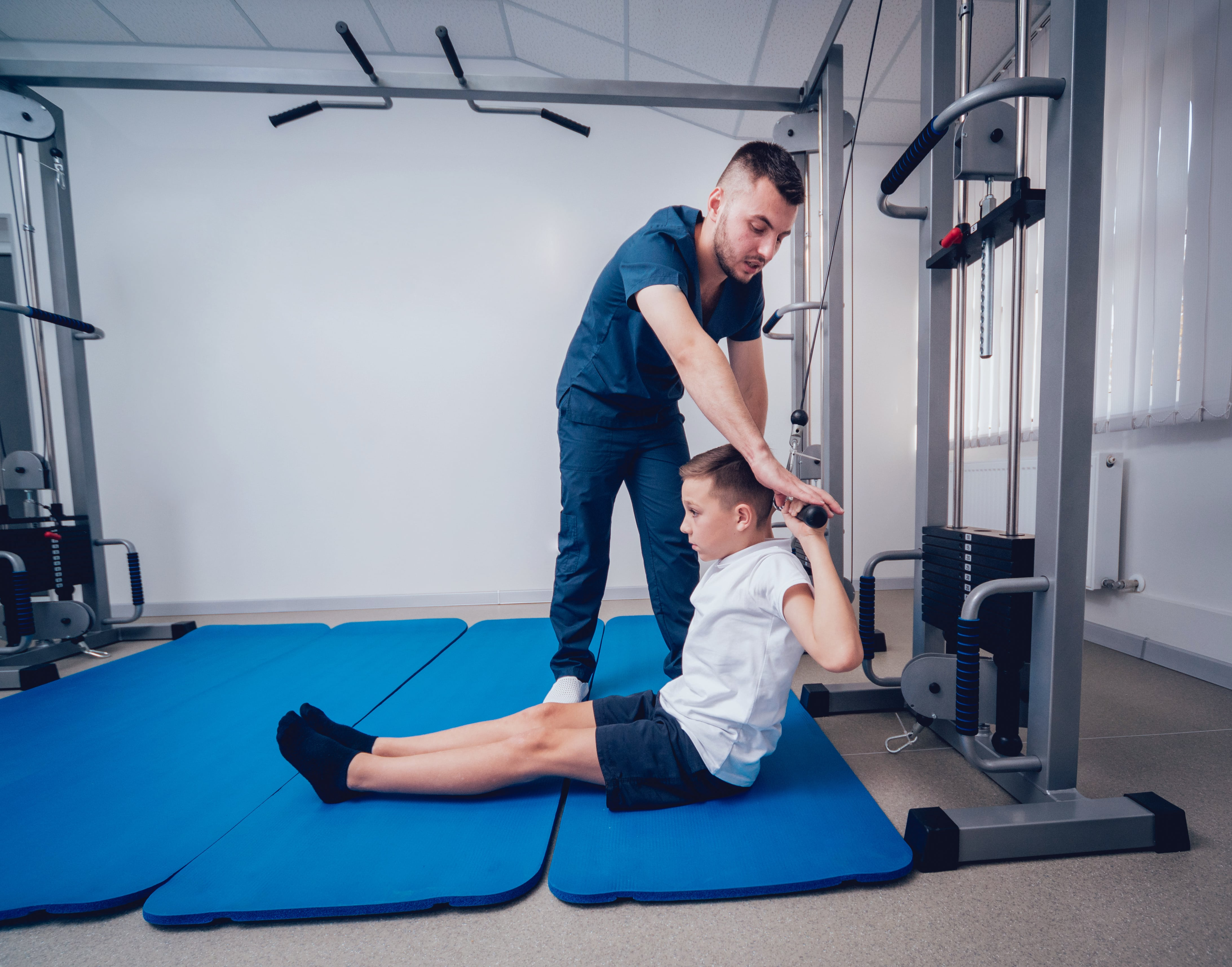 Young boy doing exercises with physical therapist