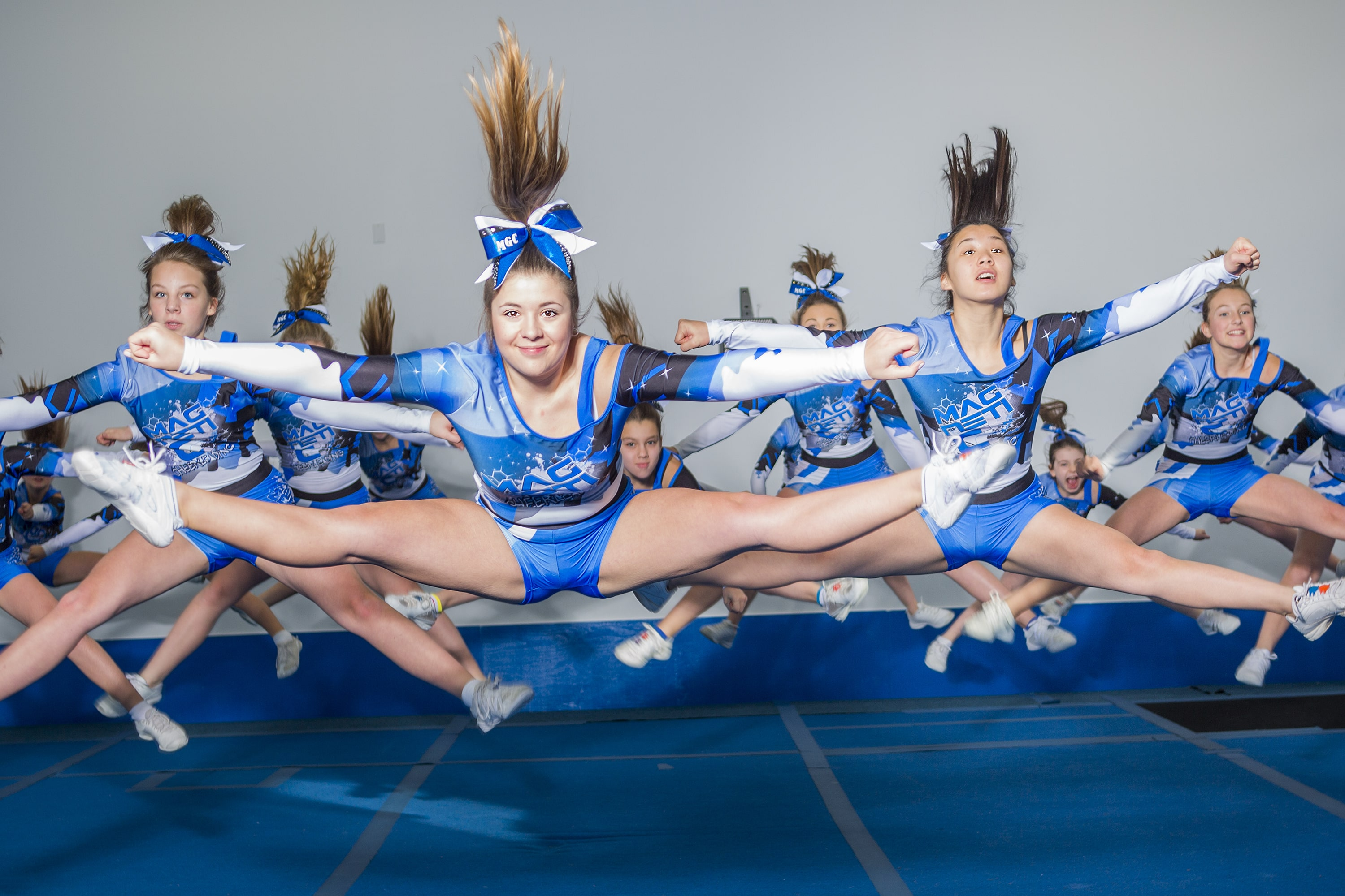 Cheerleading team jumping up into the air