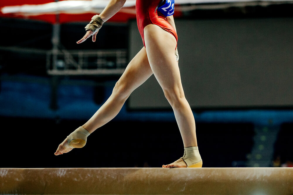 Girl walking on a balance beam