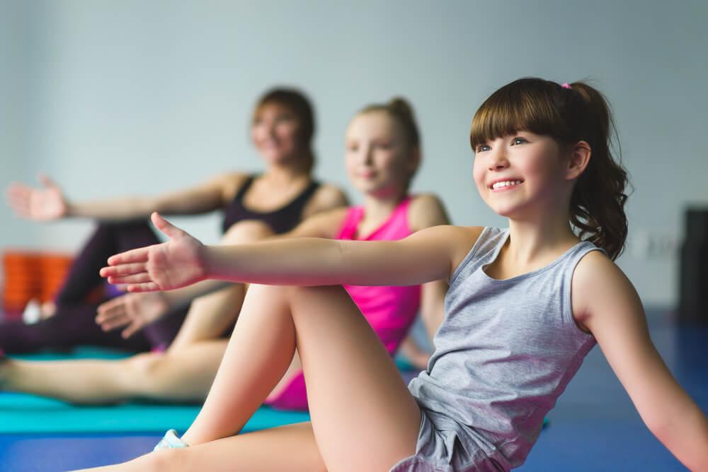 Girls stretching on mats