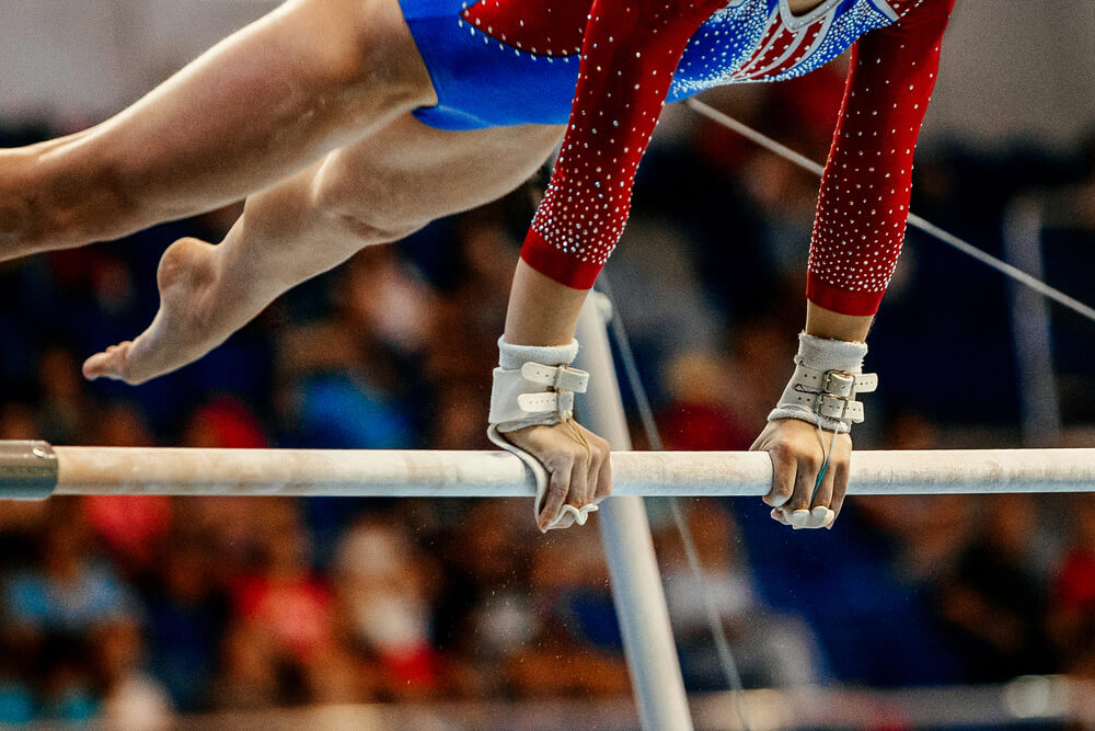 Gymnastics competitor working on uneven bars