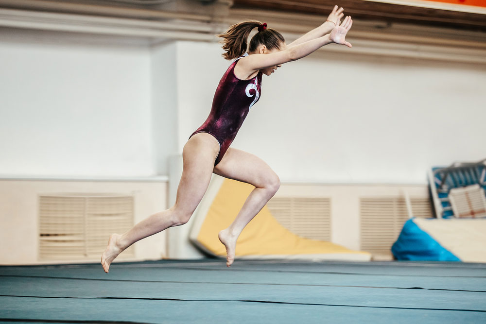 Woman about to perform a front handspring