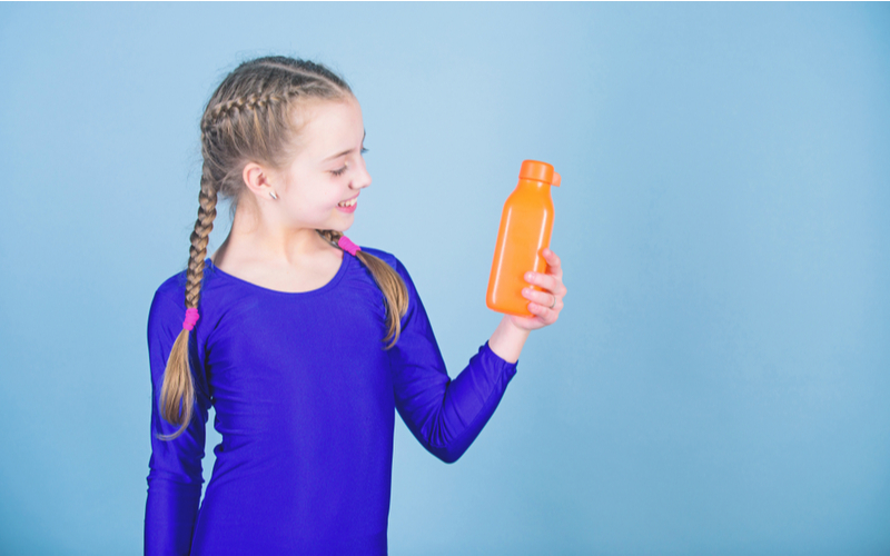 Young gymnast holding a water bottle
